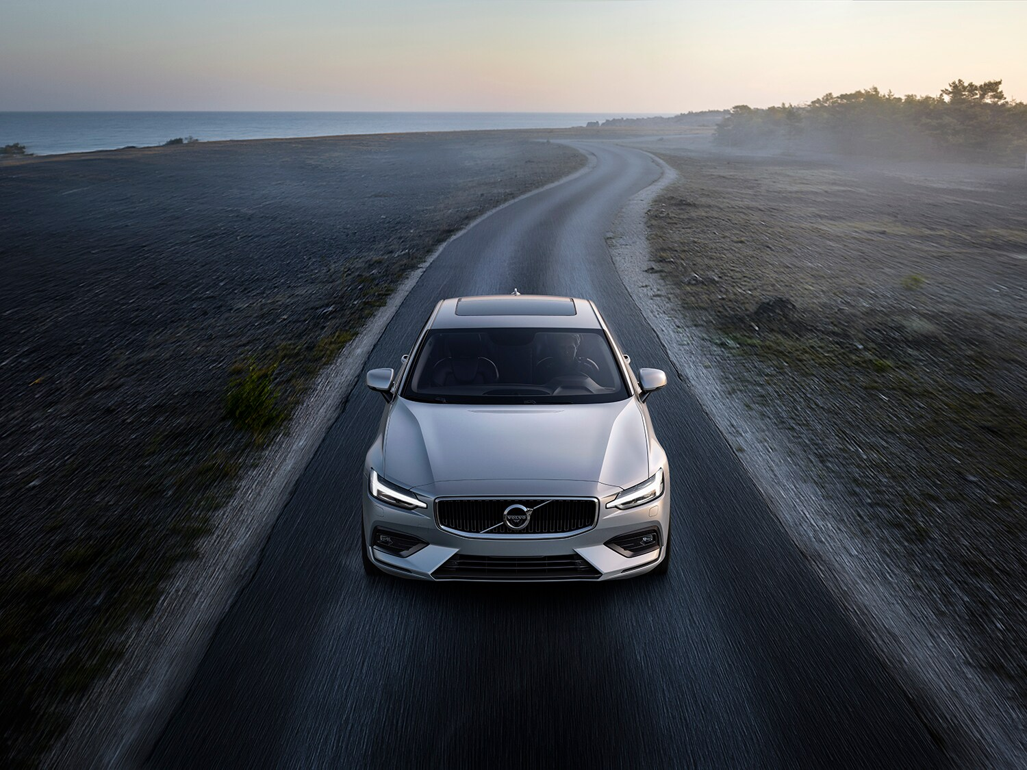 The new Volvo S60 Momentum, driving along a deserted coastal road