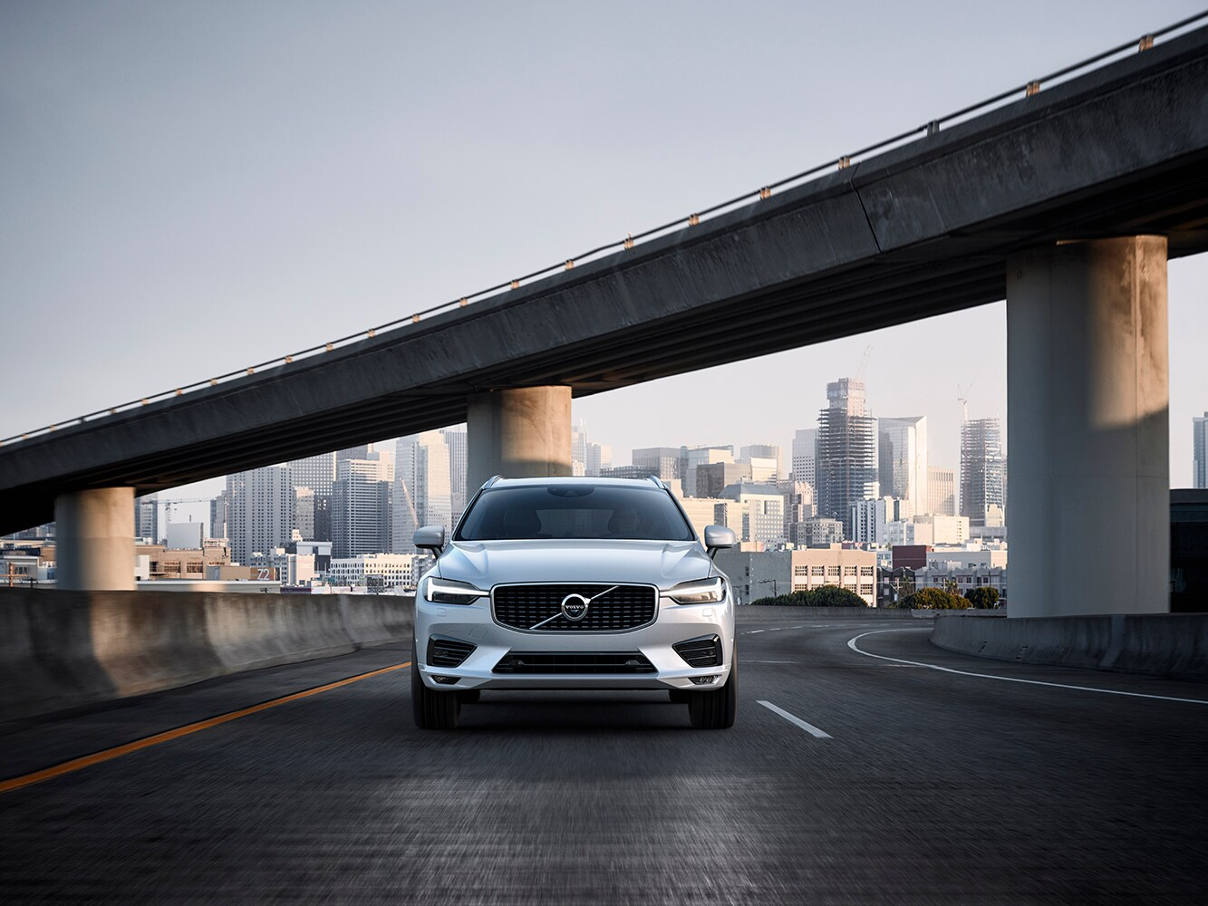 Front view of the new Volvo XC60 R-Design driving on a freeway
