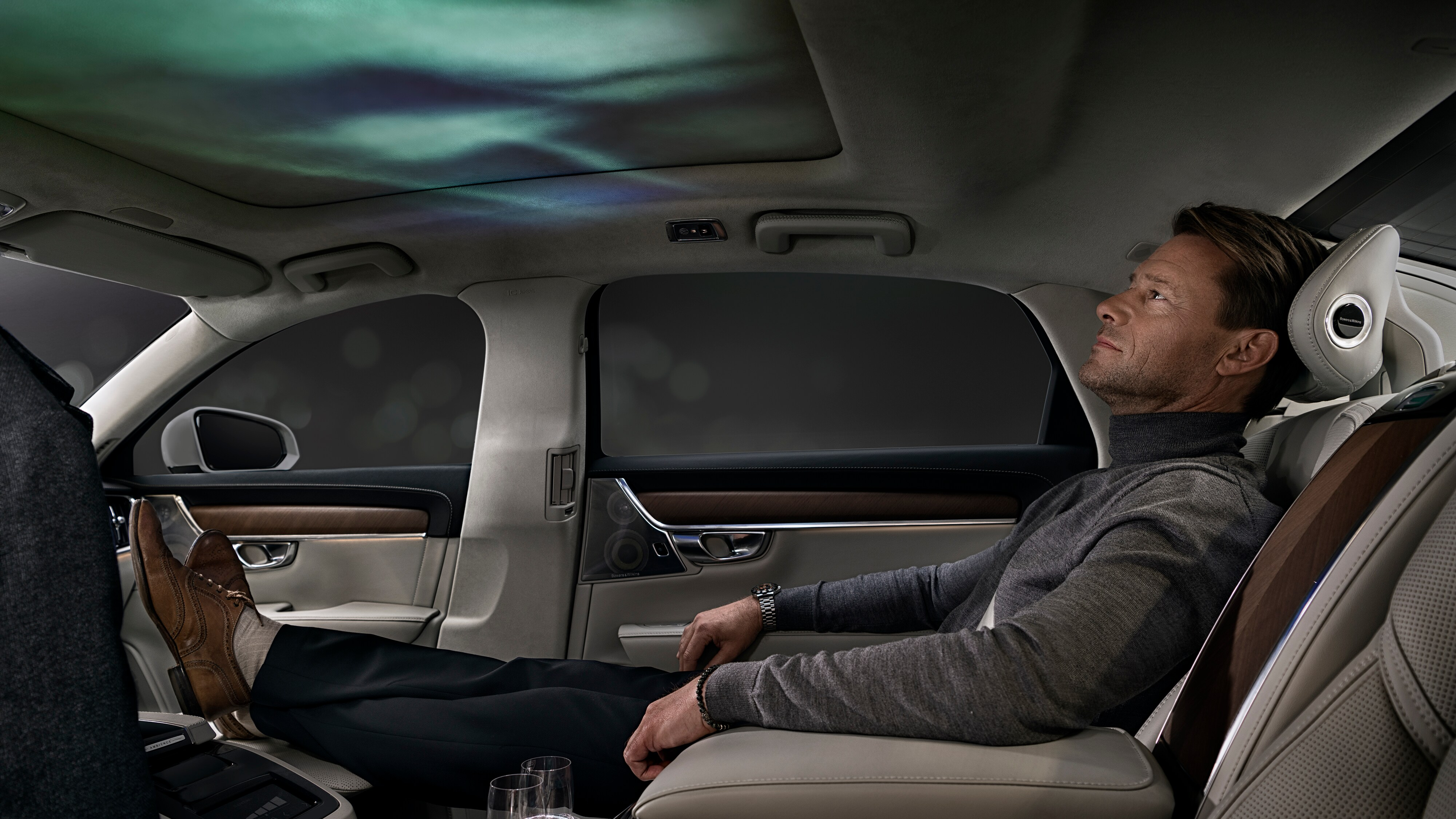 A Volvo owner relaxes in his Volvo enjoying the Ambience Interior.