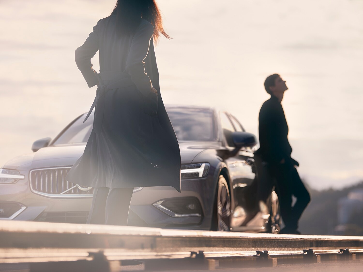 A man and woman meet by the new Volvo S60