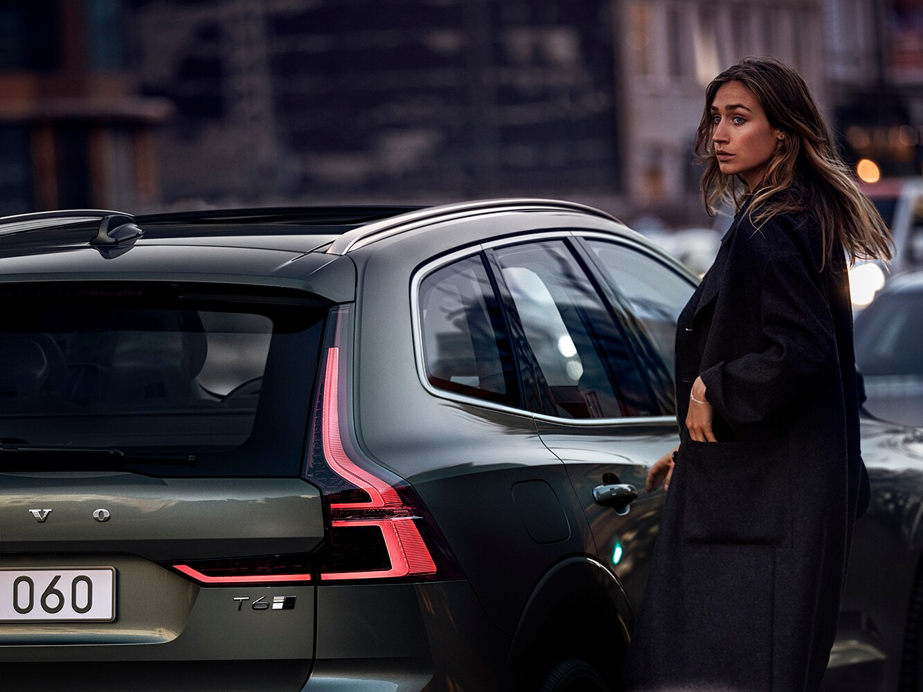 A woman stands in front of the new Volvo XC60