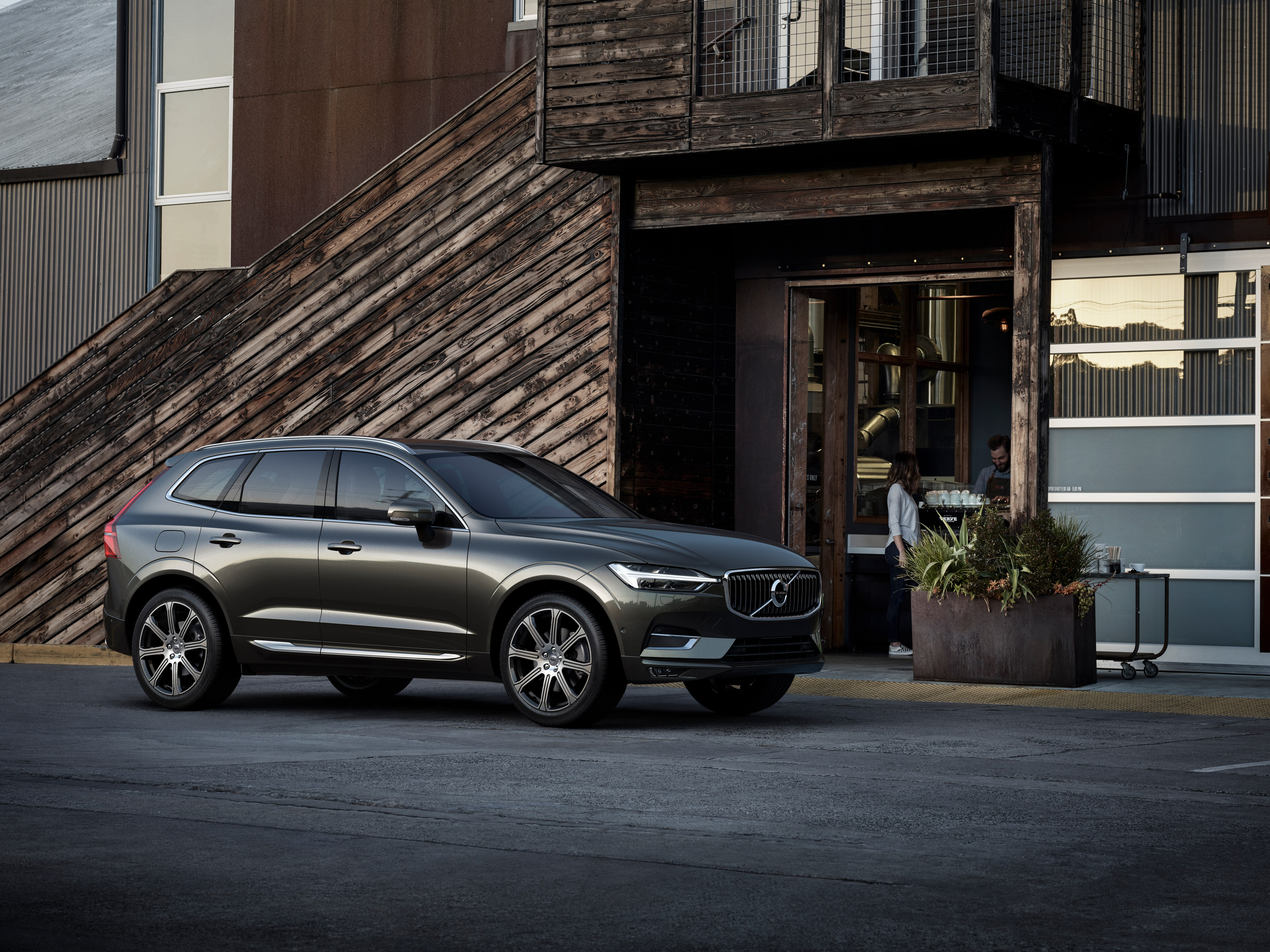 The new Volvo XC60 Incription luxury trim parked in front of a café