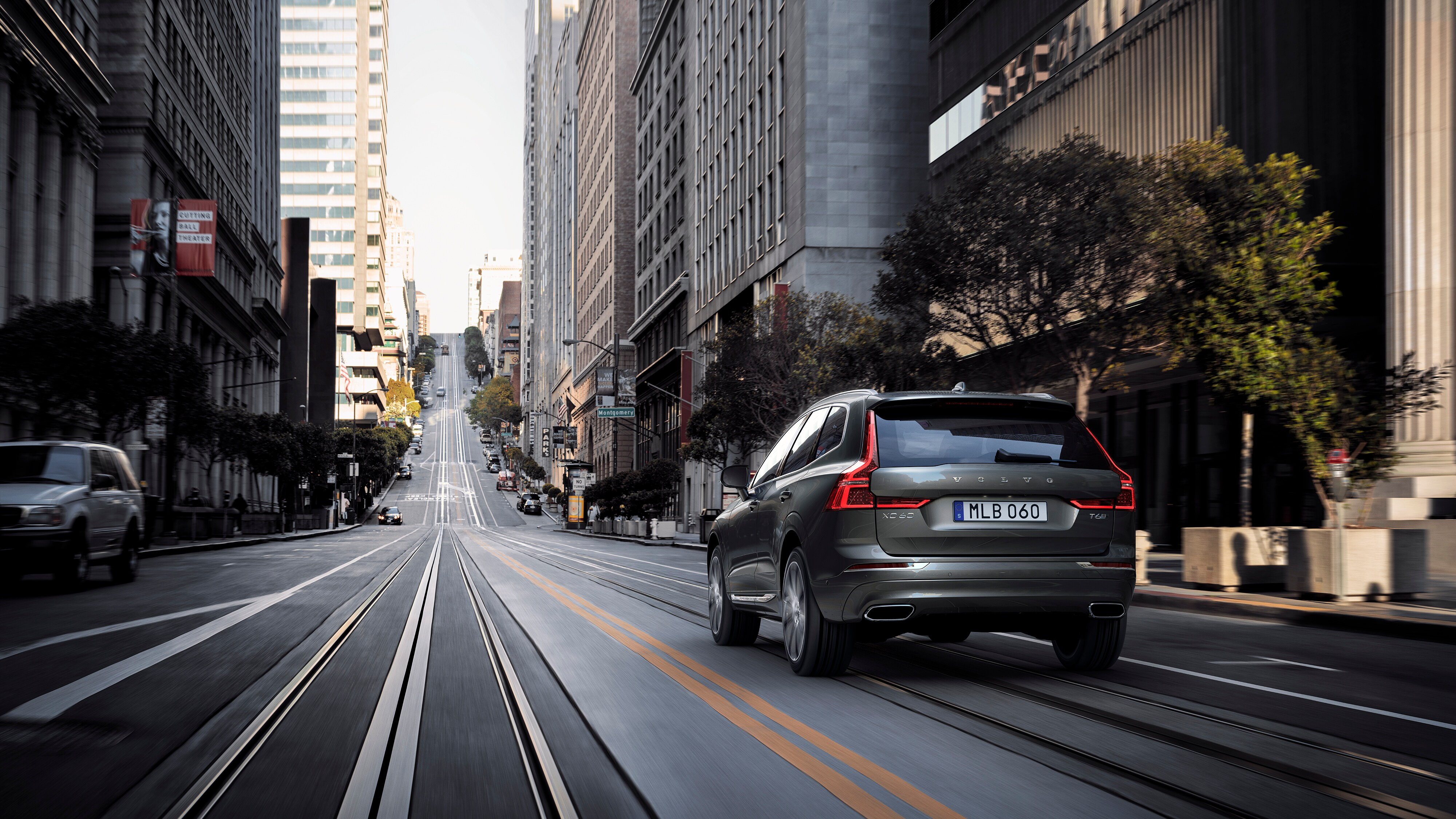 The new Volvo XC60 Incription luxury trim driving down a city street