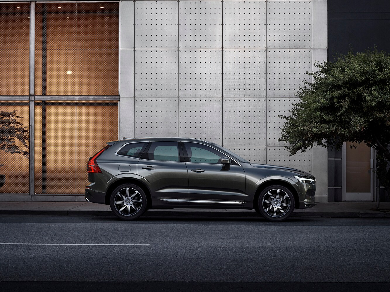 The new Volvo XC60 parked on a city street, available in two trim variants