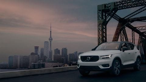 A Volvo XC40 fleet car driving over a bridge
