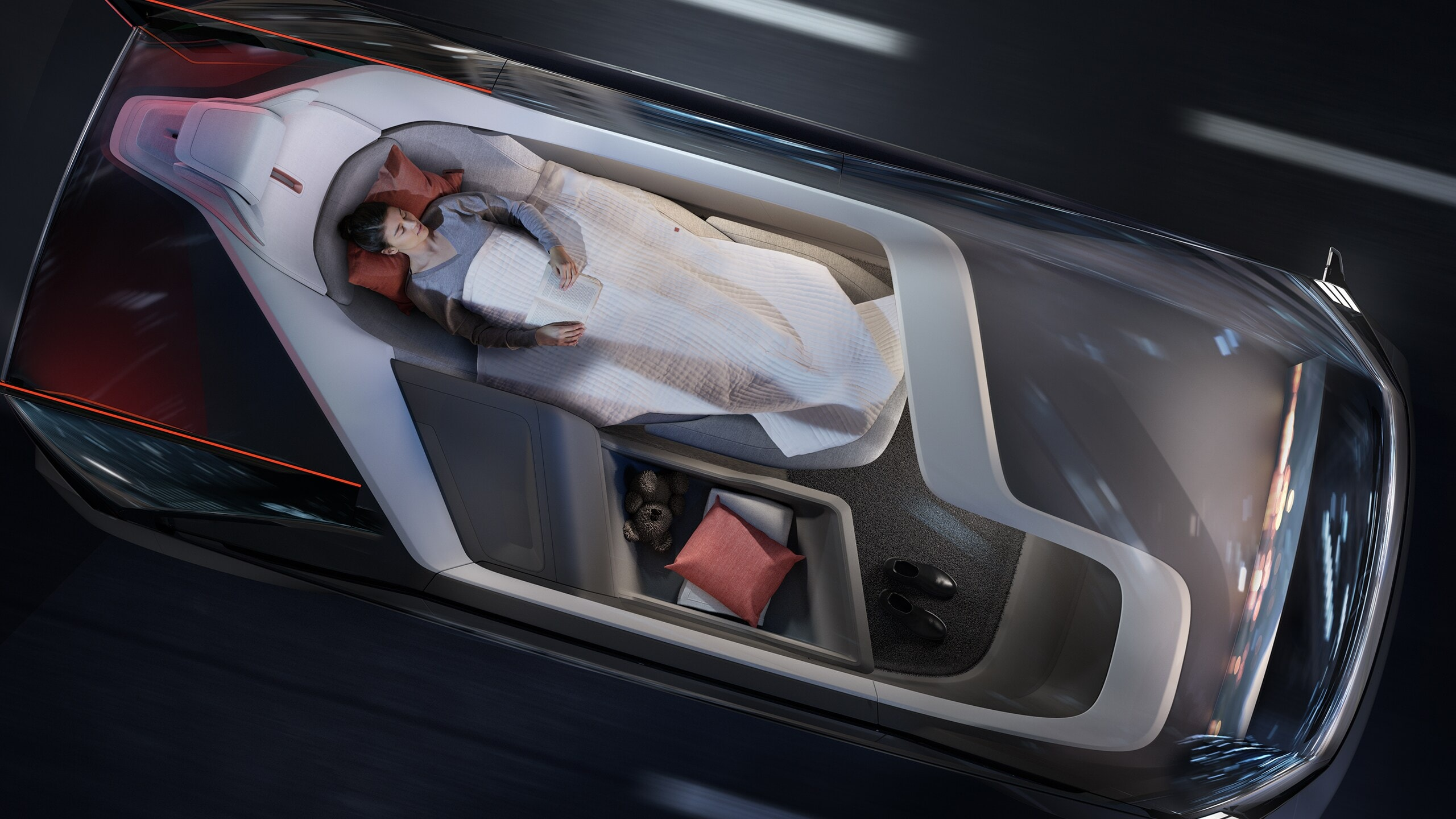 Woman utilising the Volvo autonomous drive to the fullest by enjoying a night's sleep