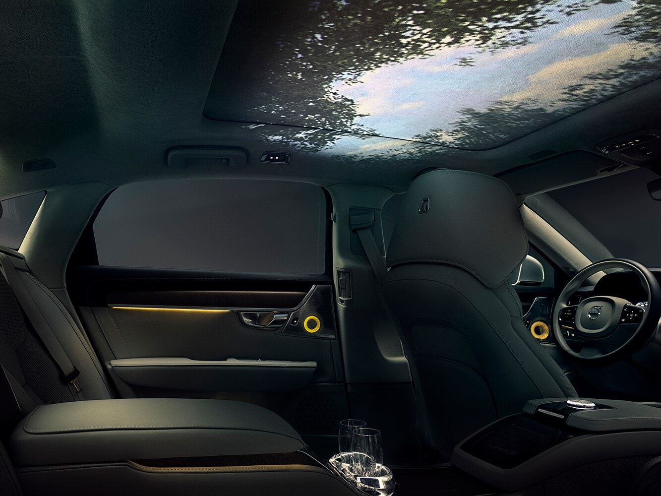 Interior of our concept for multi-sensory in-car experience with a panoramic forest sky view in the car ceiling