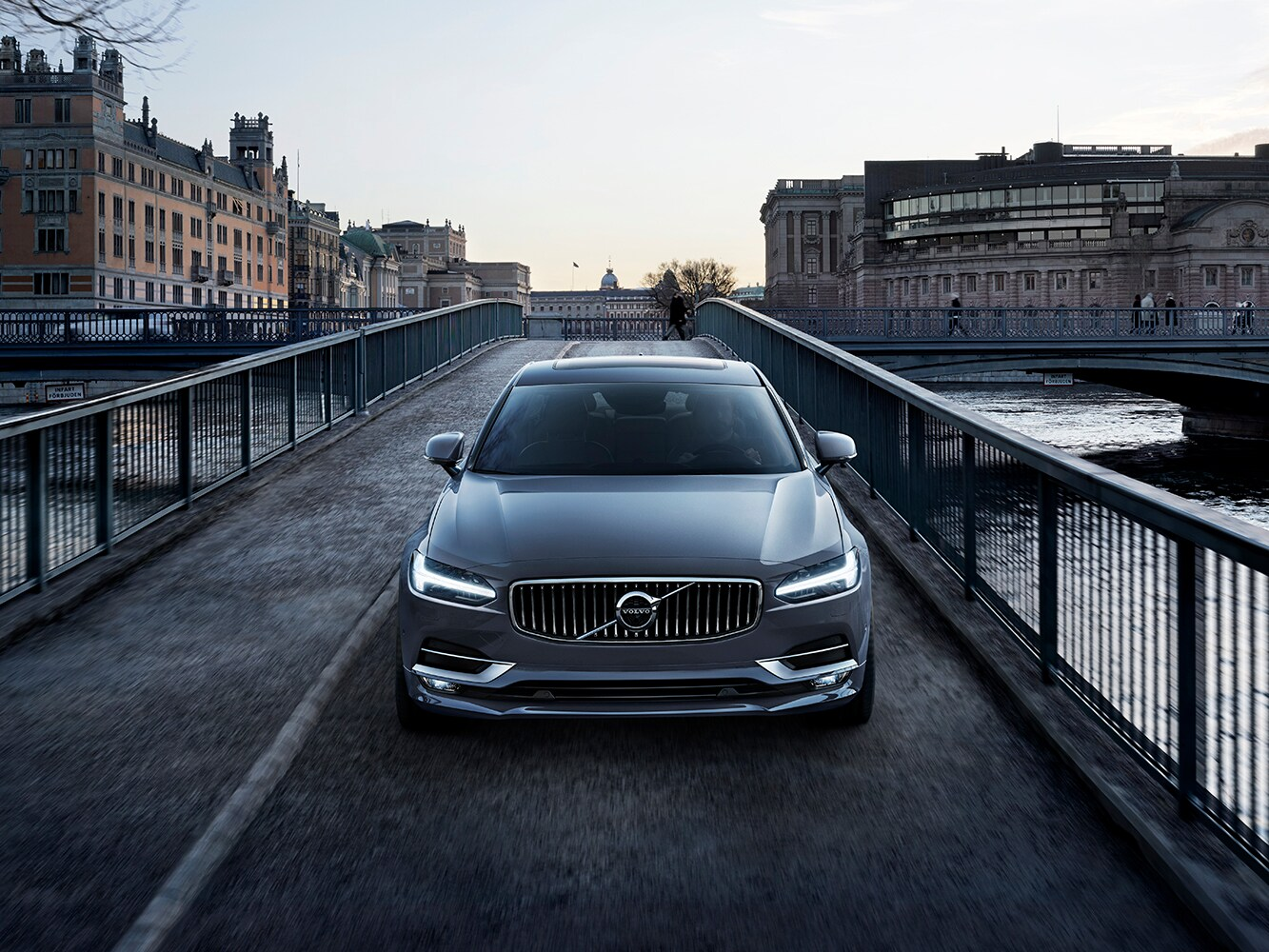 Front view of a Volvo S90 crossing a bridge