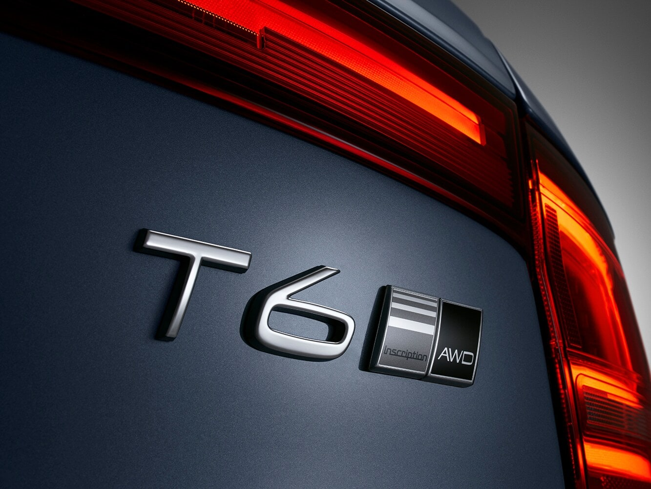 Close up detail of the T6 badge on a Volvo S90