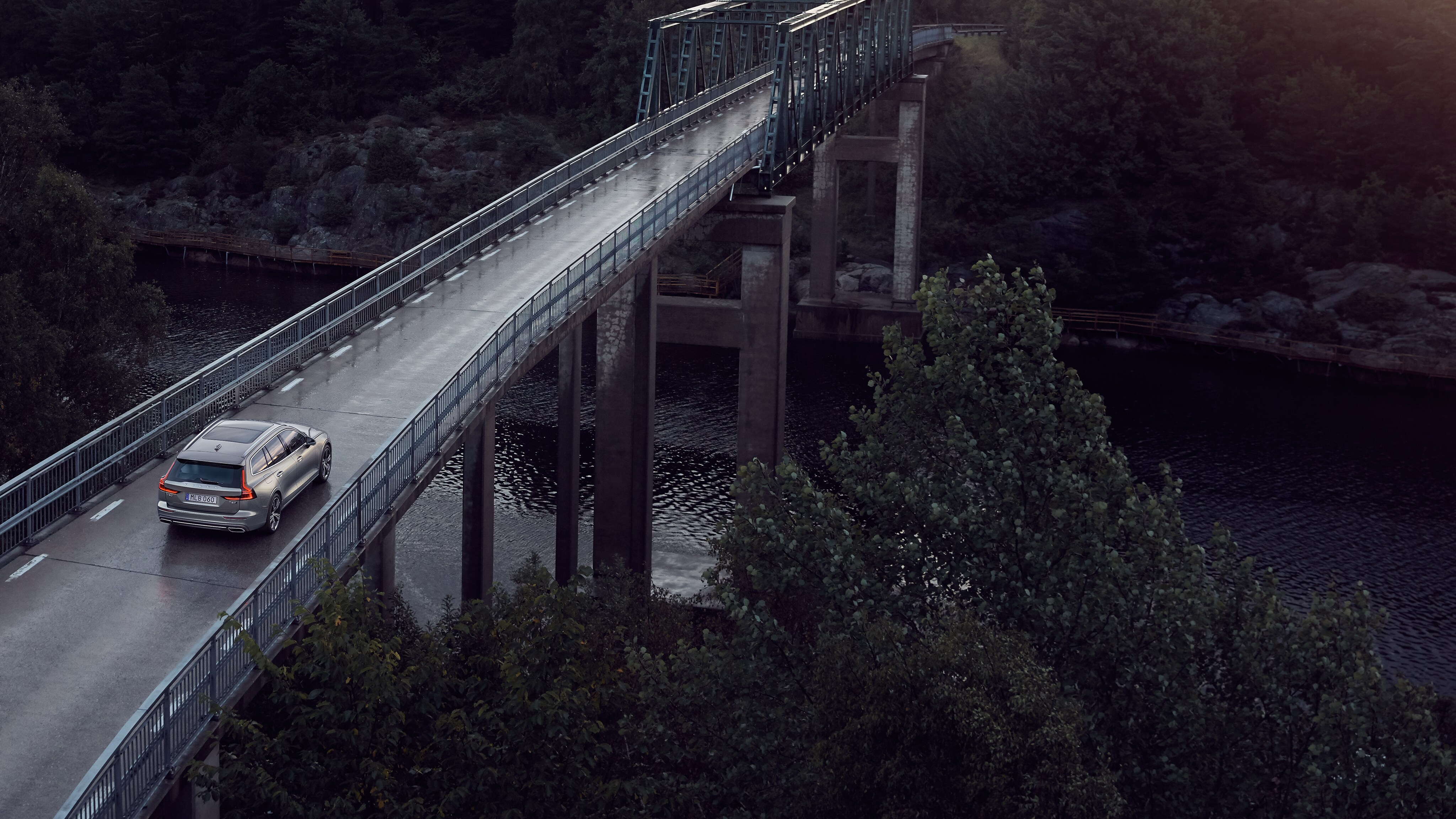Volvo V60 driving over a bridge