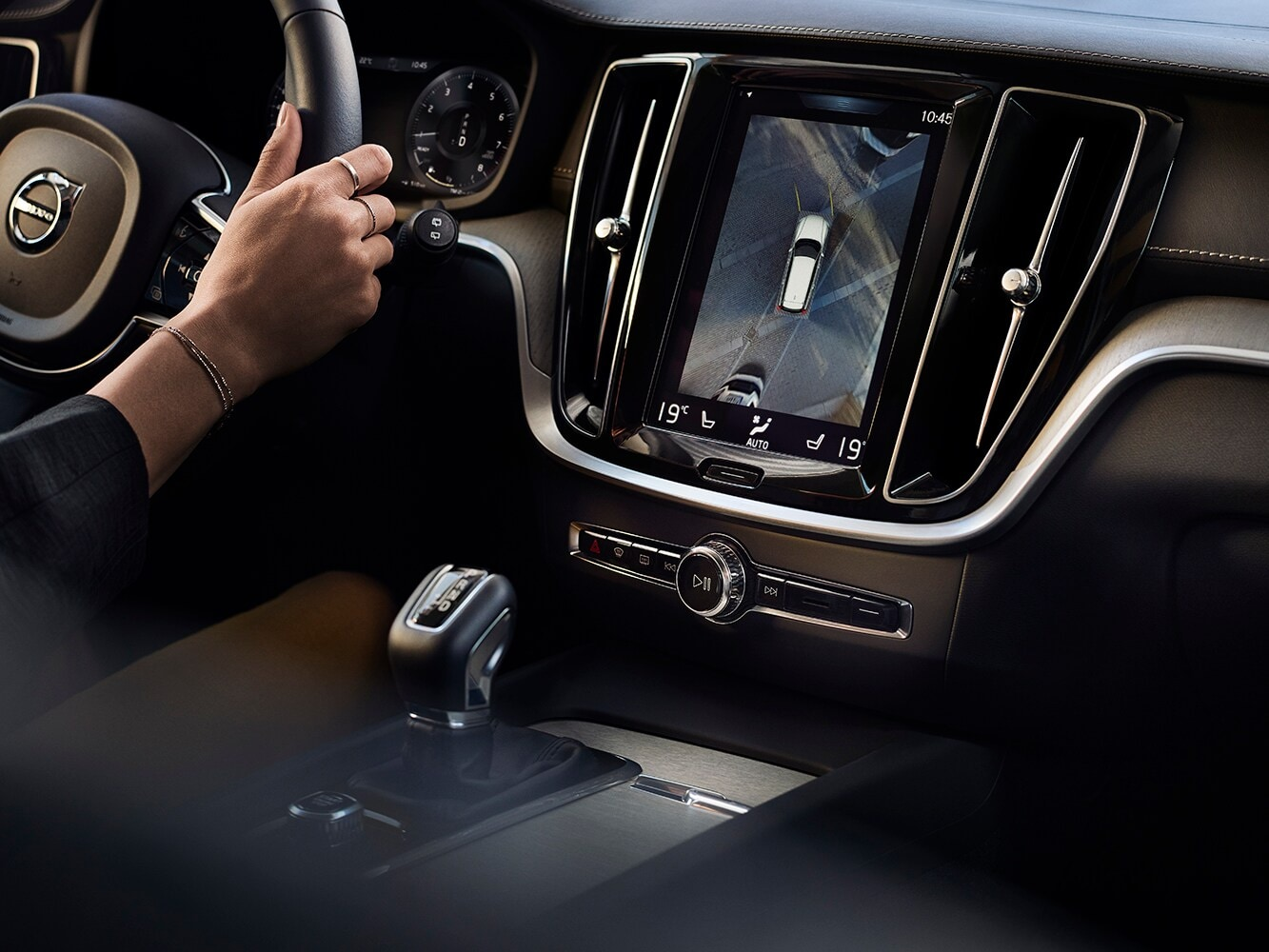View of the interior of a Volvo V60 showing the driver's wheel and centre console