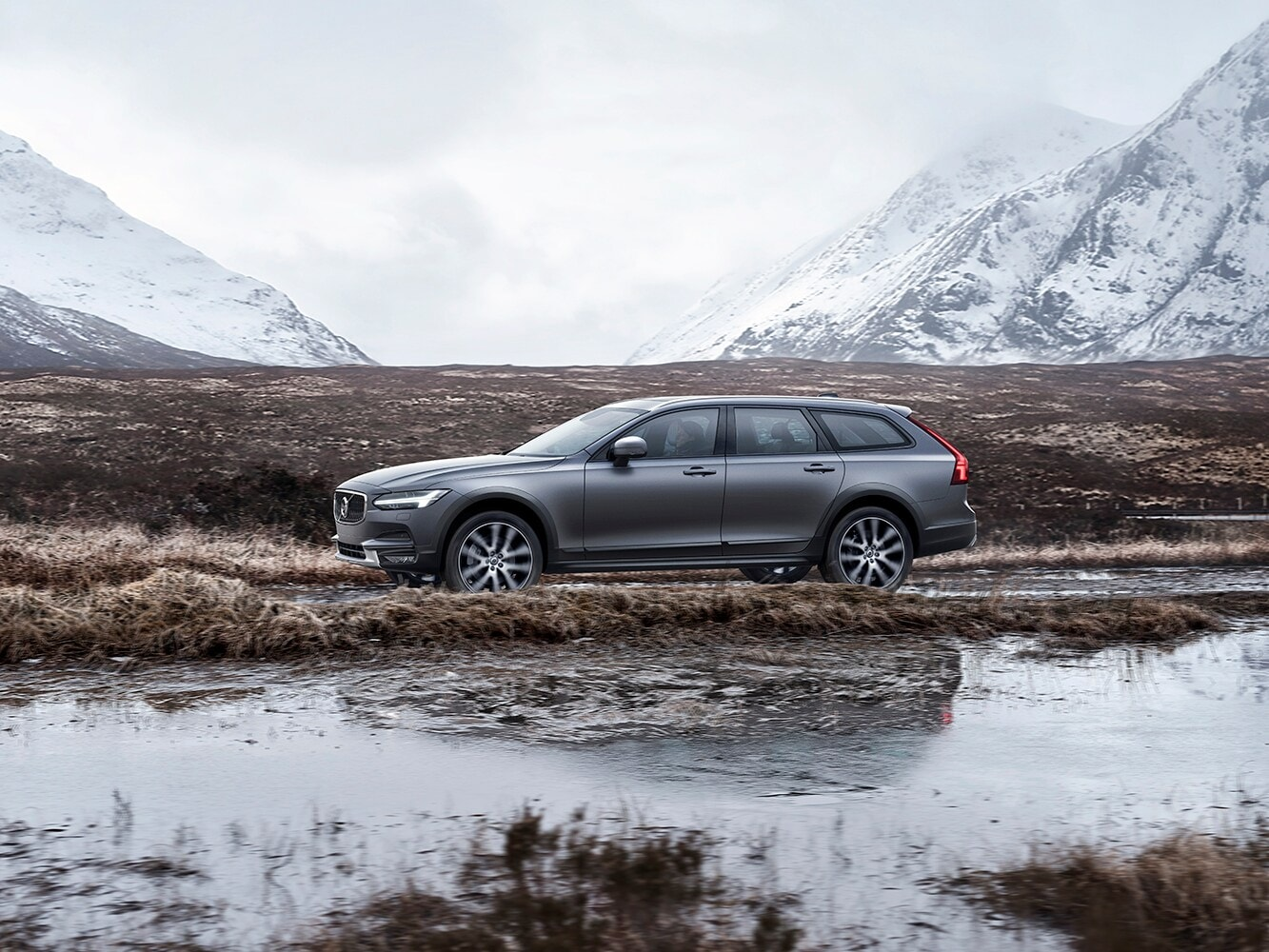 The Volvo V90 Cross Country trim parked next to a marsh
