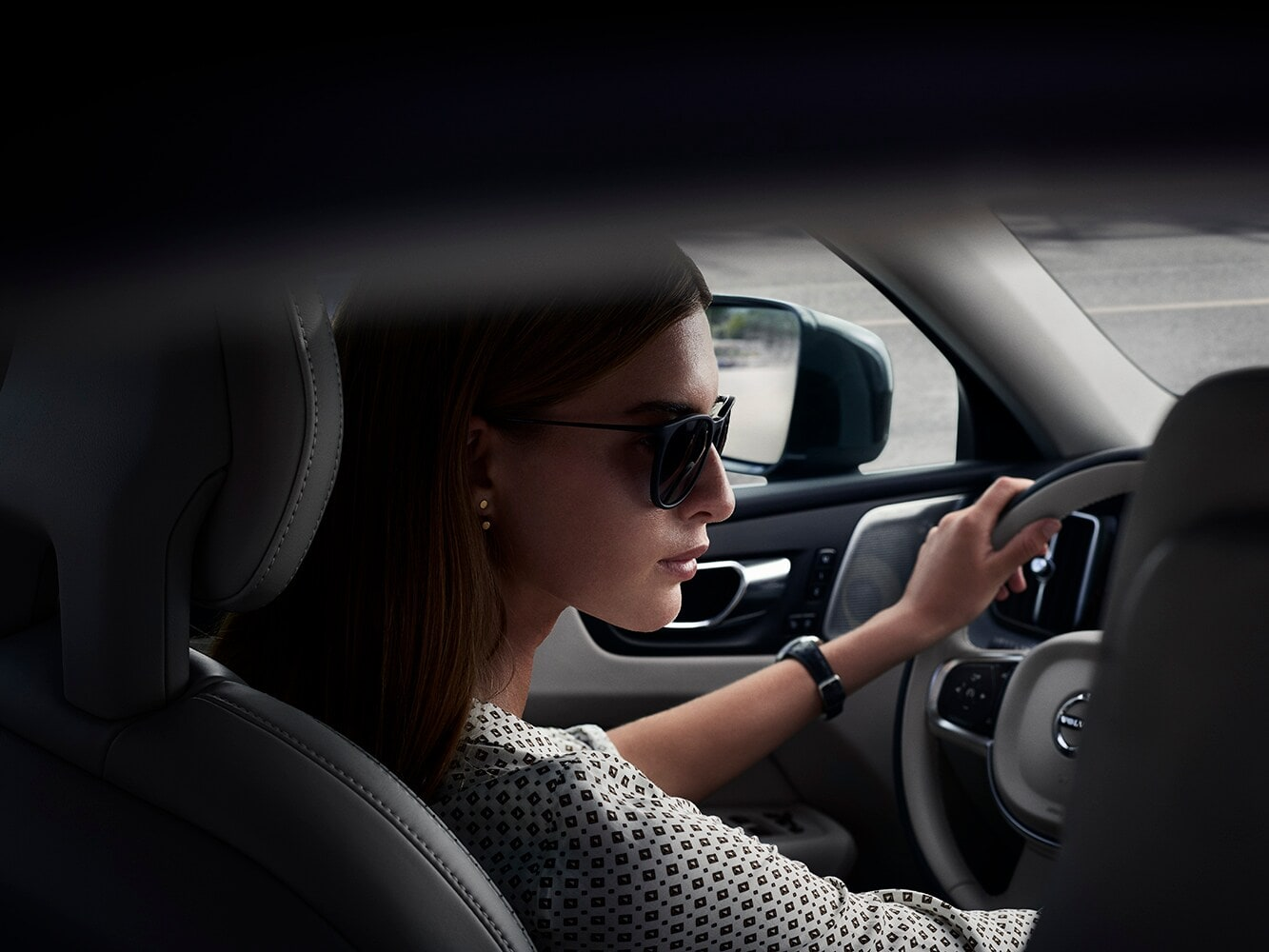 Candid portrait shot of a driver in a Volvo V90