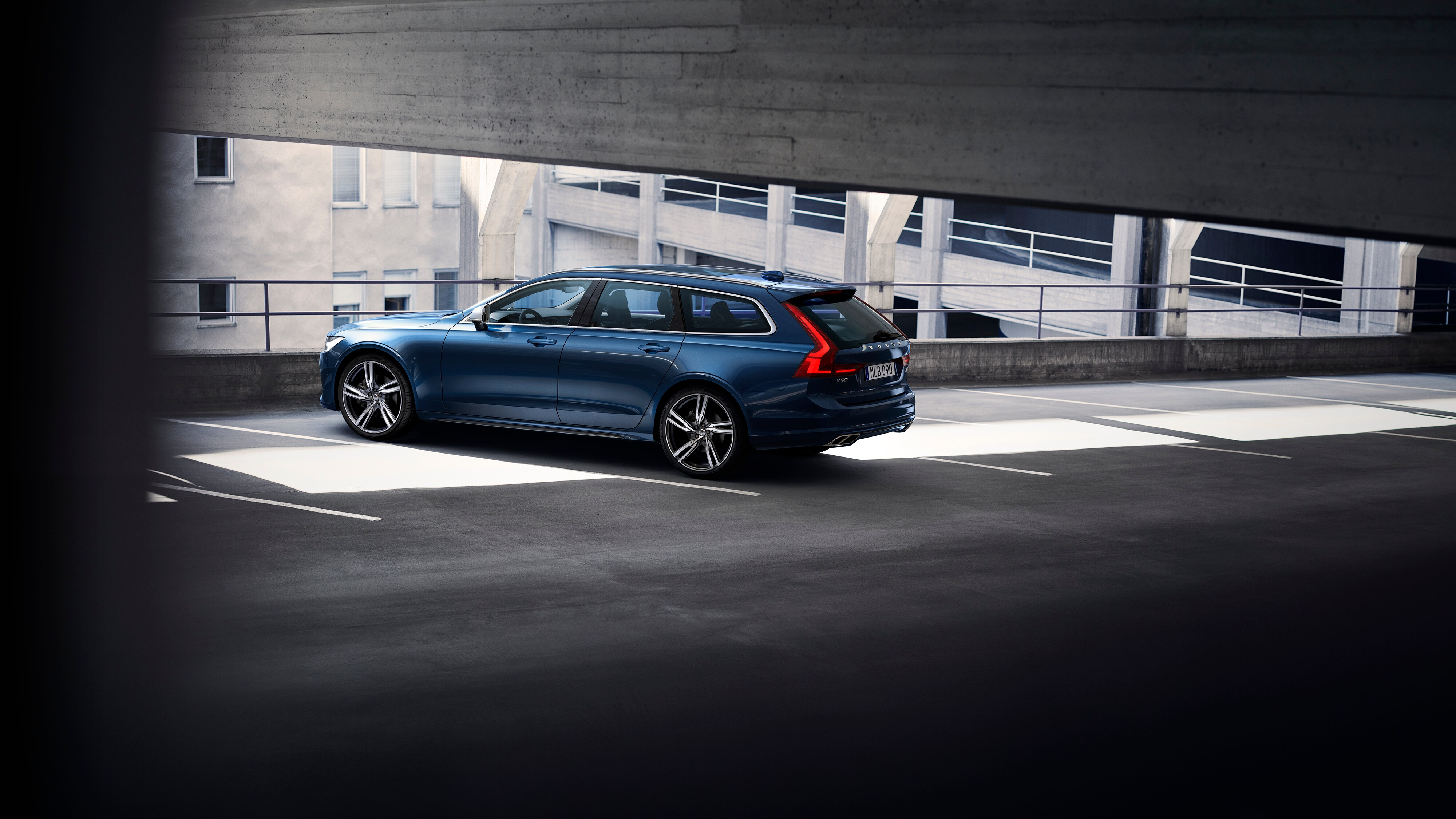 Side-rear view of Volvo V90 R-Design in multi-storey car park