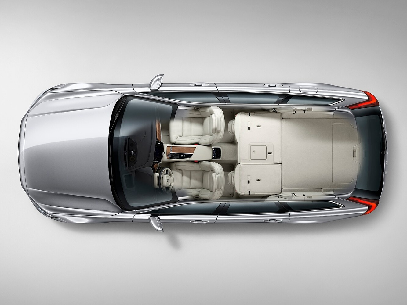 Top down cutaway view of the Volvo V90 showing the interior seat layout from above