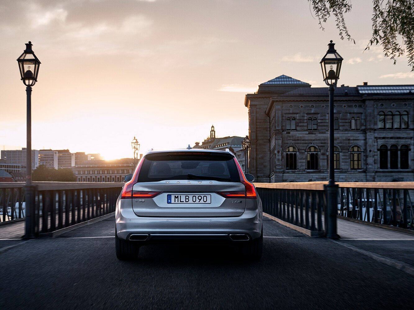 Rear view of Volvo V90 crossing a bridge