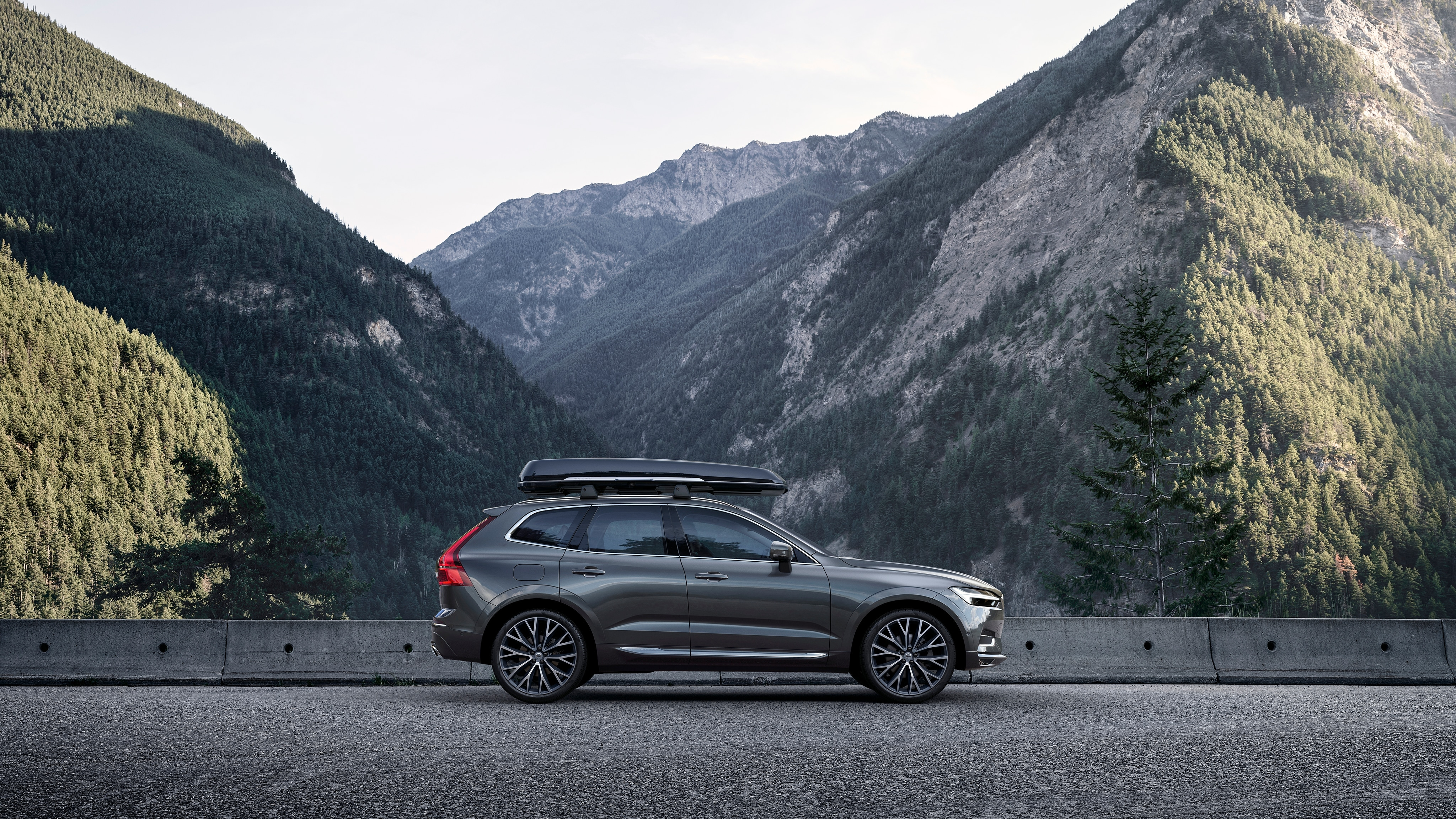 XC60 with roof mounted cargo box parked on mountain road