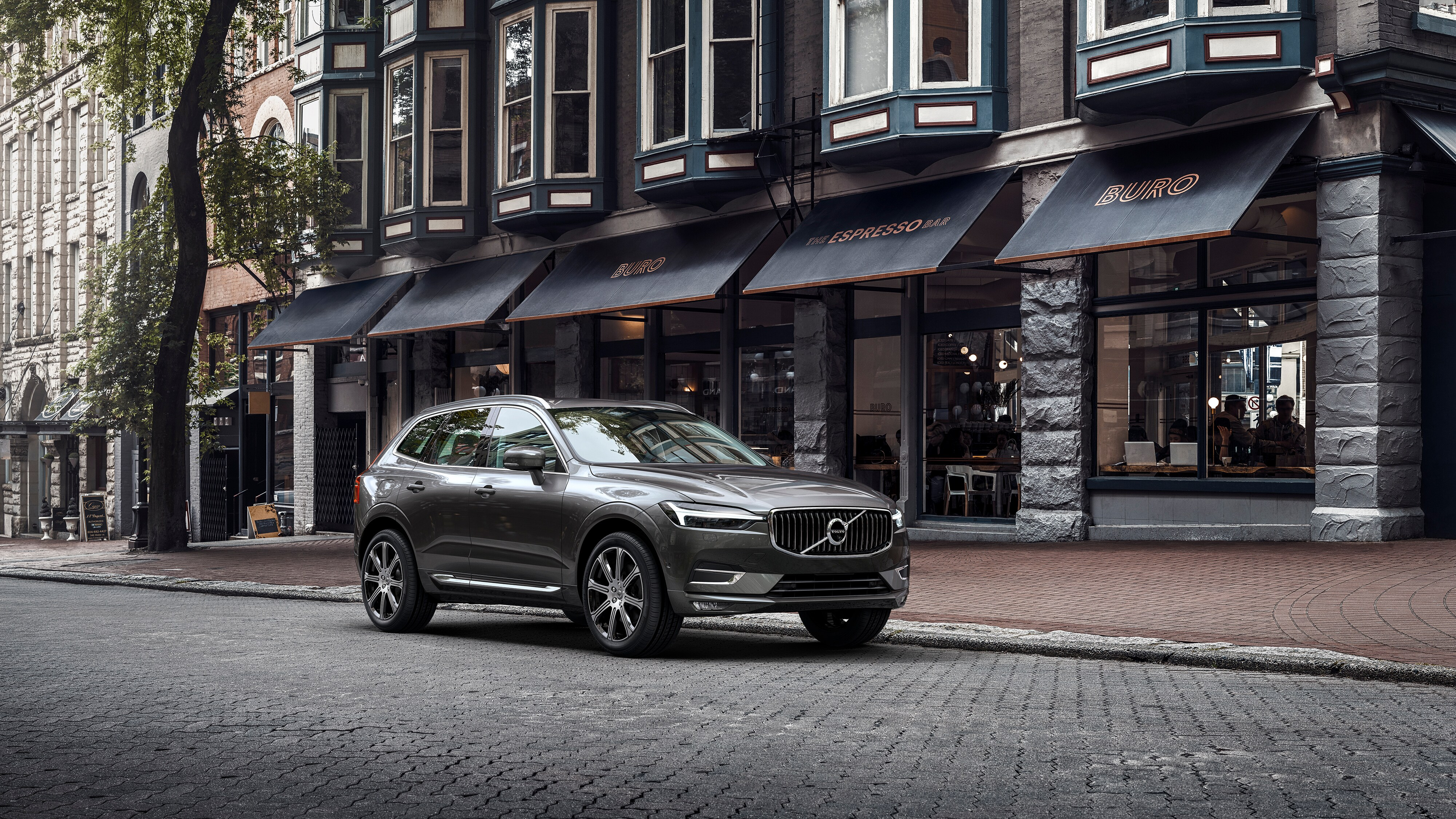 The new Volvo XC60 parked in front of a café
