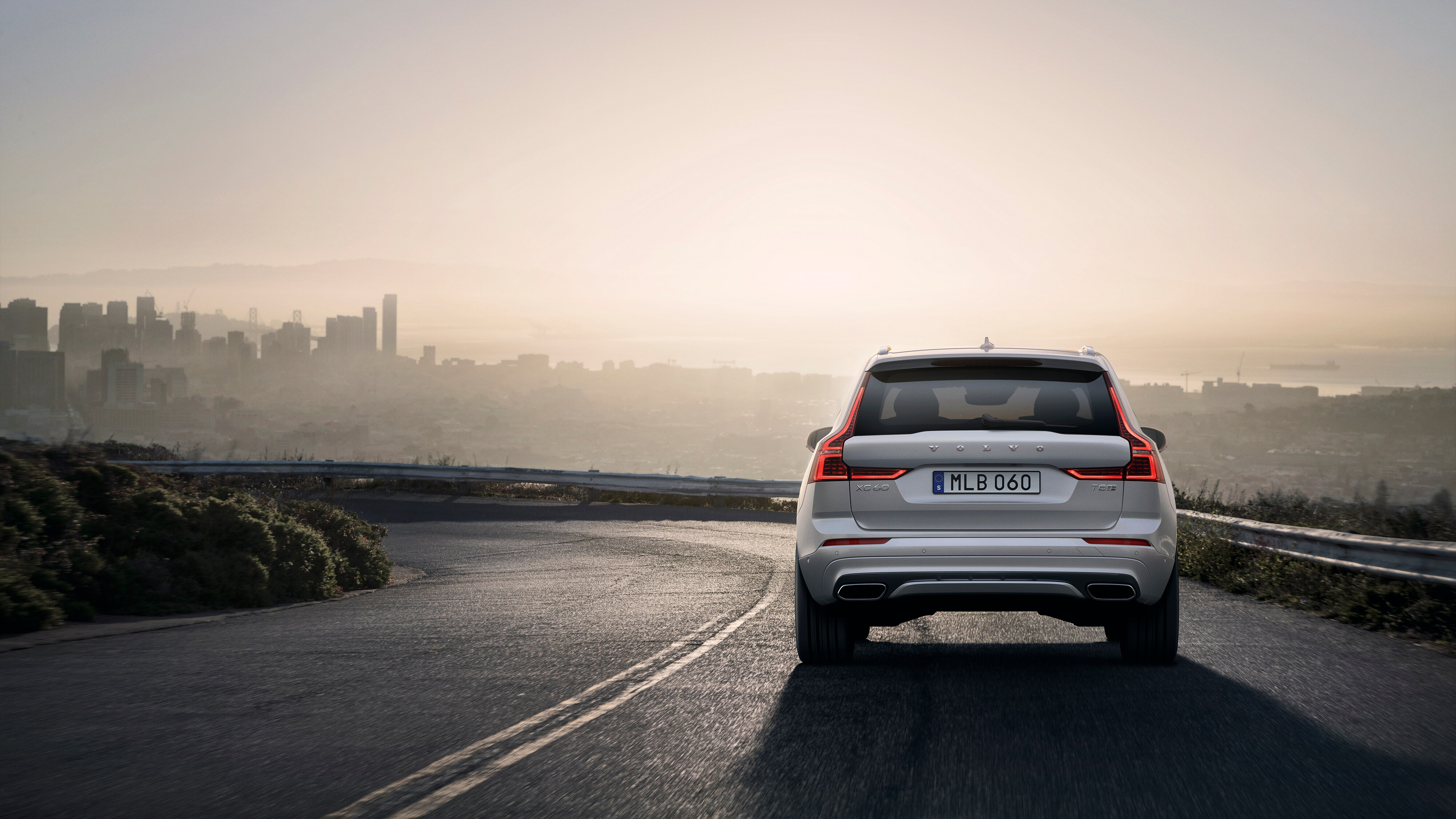 The Sporty new Volvo XC60 R-Design SUV driving on a road outside the city