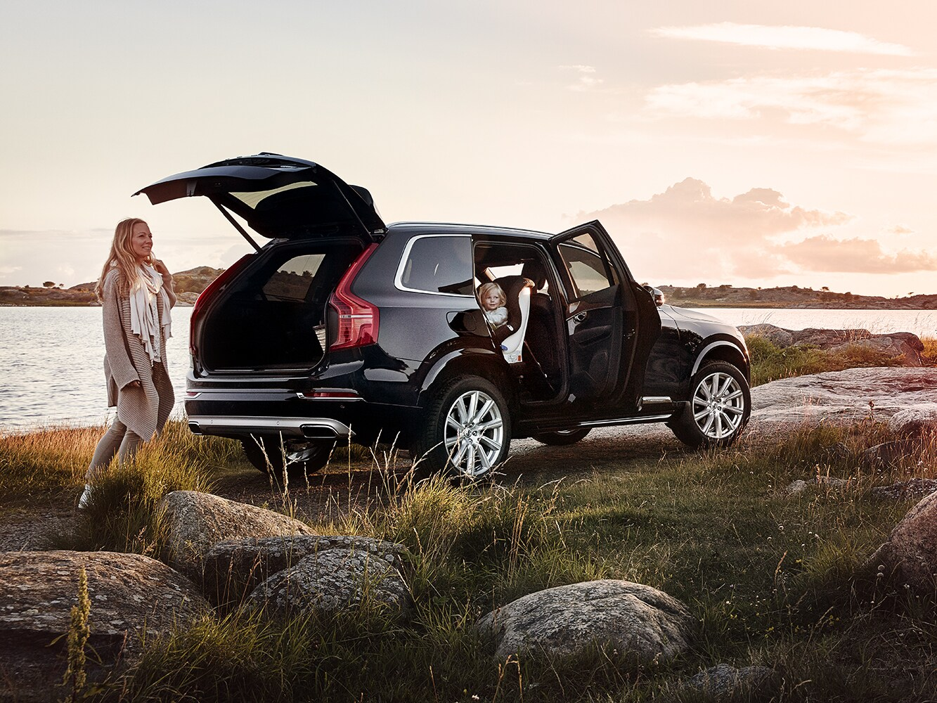 Rear side view of a Volvo XC90 with side passenger door and rear cargo door open
