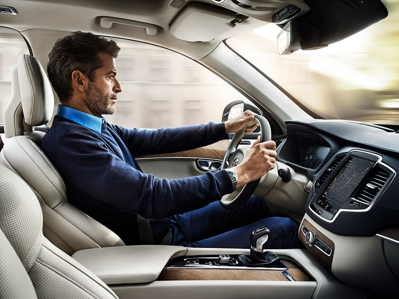 Interior view of driver in a Volvo XC90 viewed from passenger seat