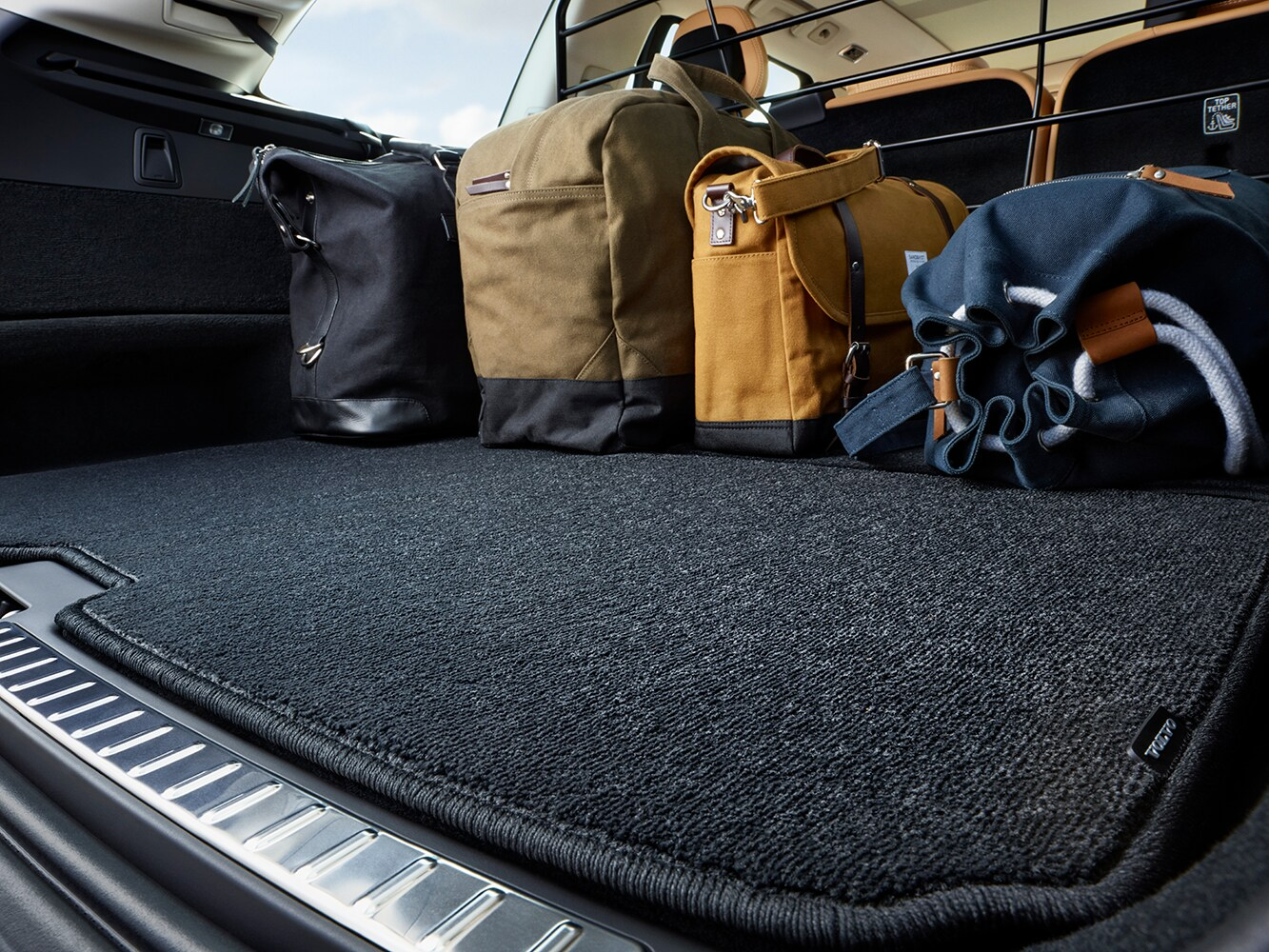 Close up view of interior of cargo space in a Volvo XC90 showing luggage