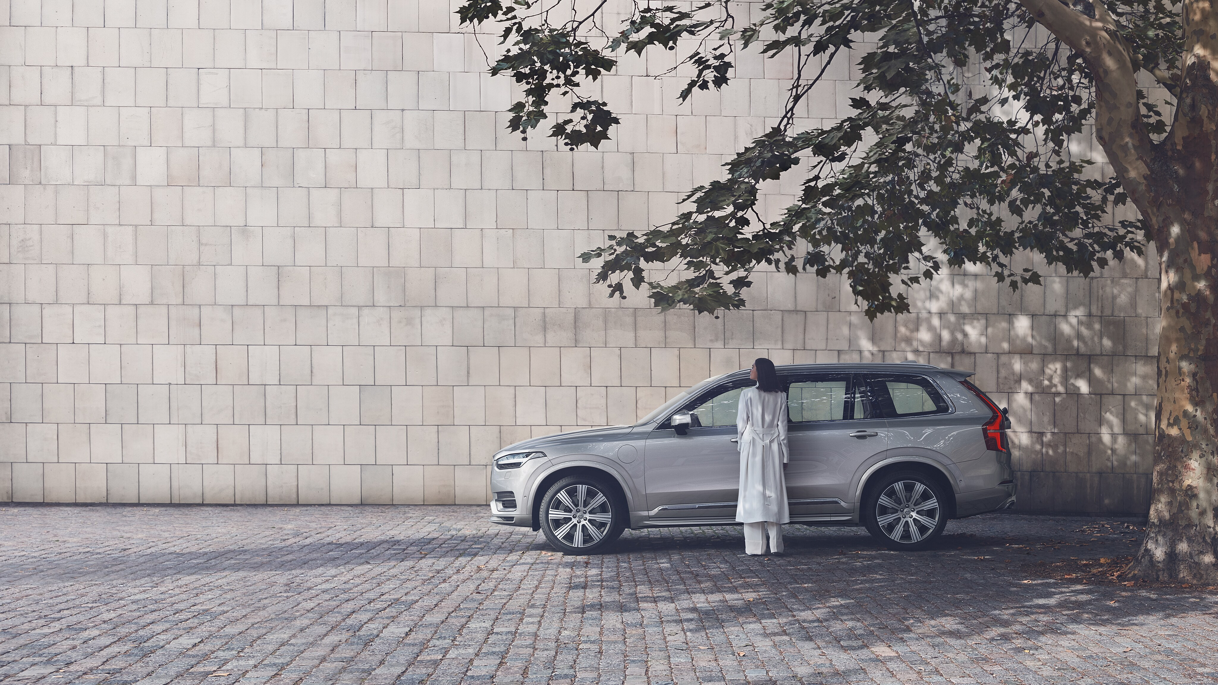 A Woman Stands By New Volvo Xc90 That S Parked In The Shade