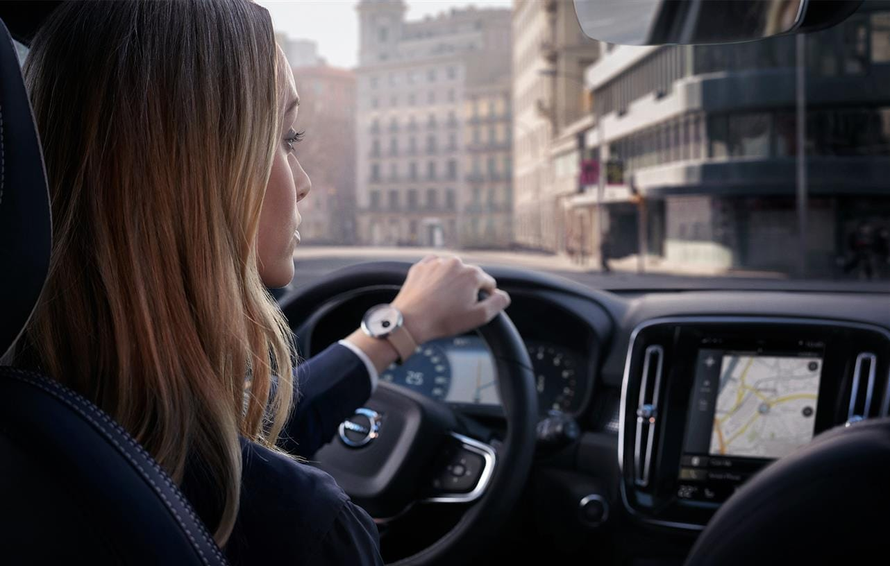 Woman looking at the navigational system in a Volvo XC40 compact SUV