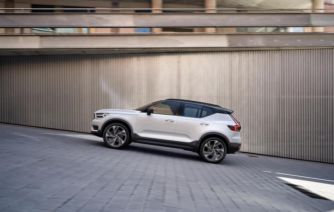 Volvo XC40 compact SUV driving up hill