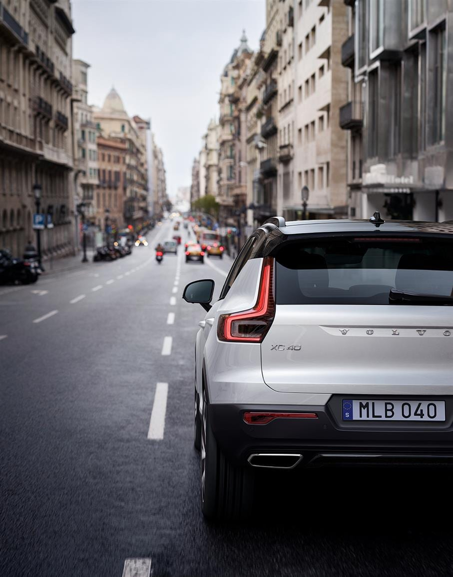 Volvo XC40 compact SUV driving on a busy city street