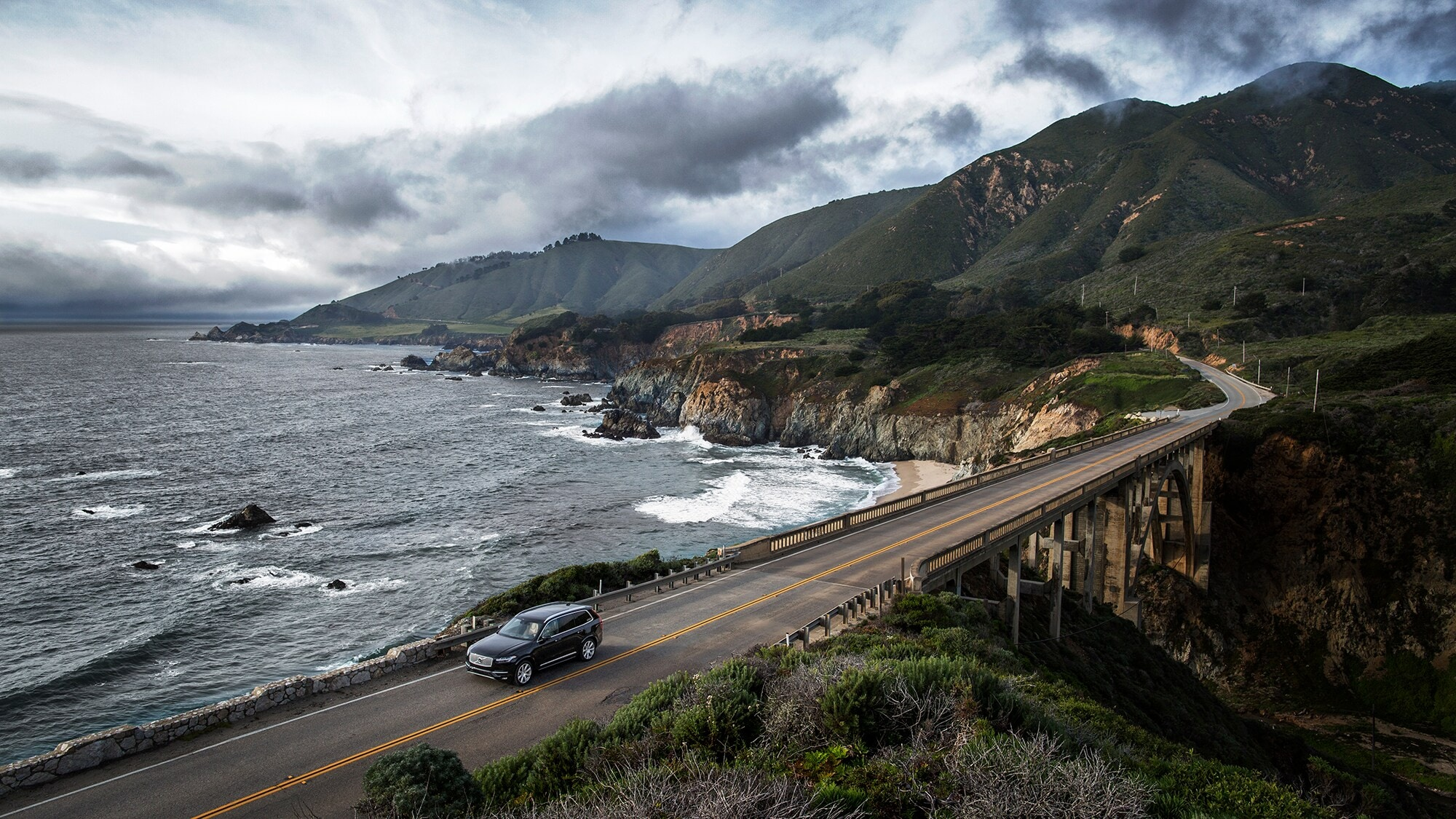 The Volvo XC90 crosses a bridge on California's dramatic Highway 1 on the Pacific coastline