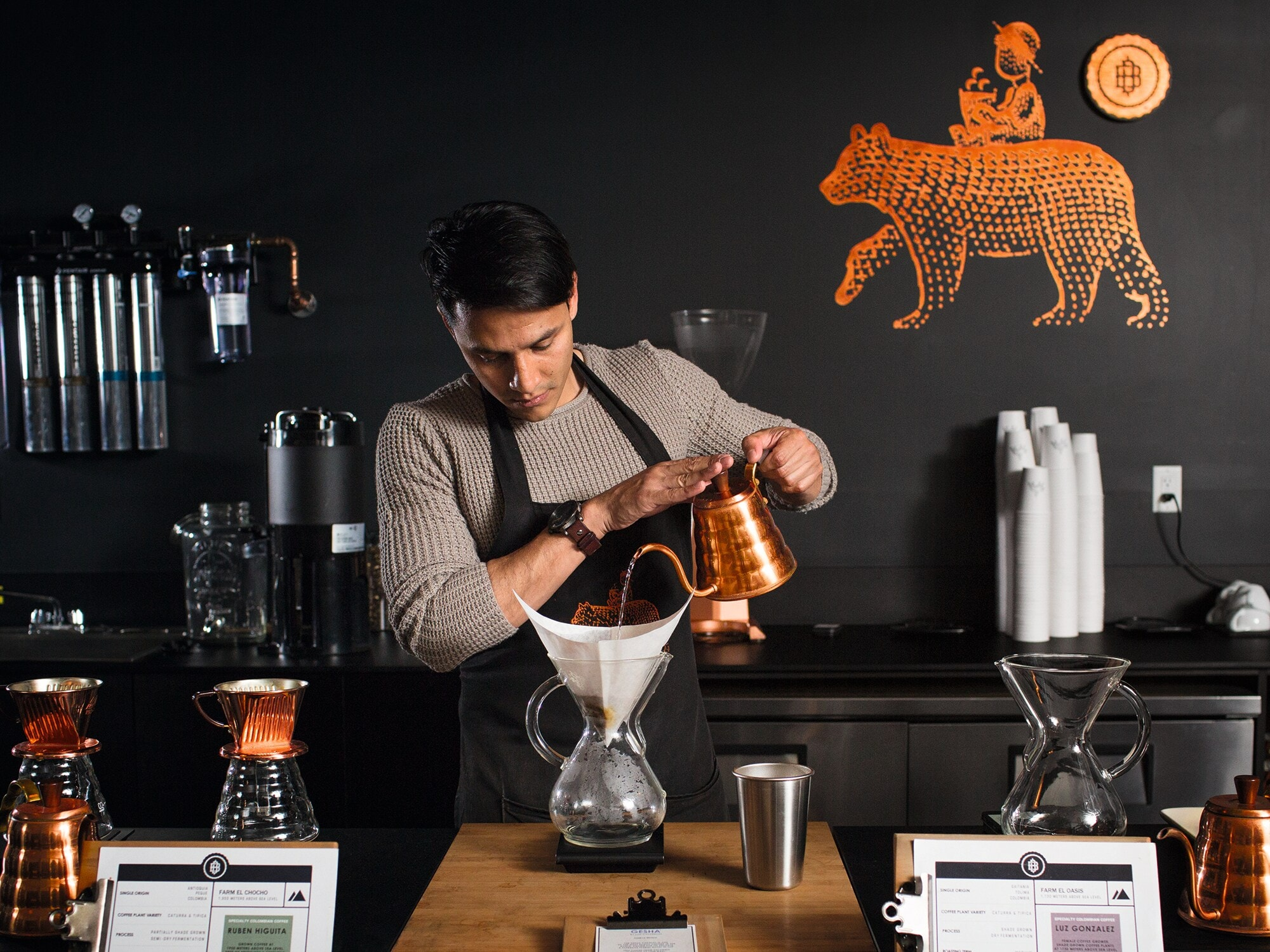 Andres of the Boy and the Bear makes coffee using a Chemex jar