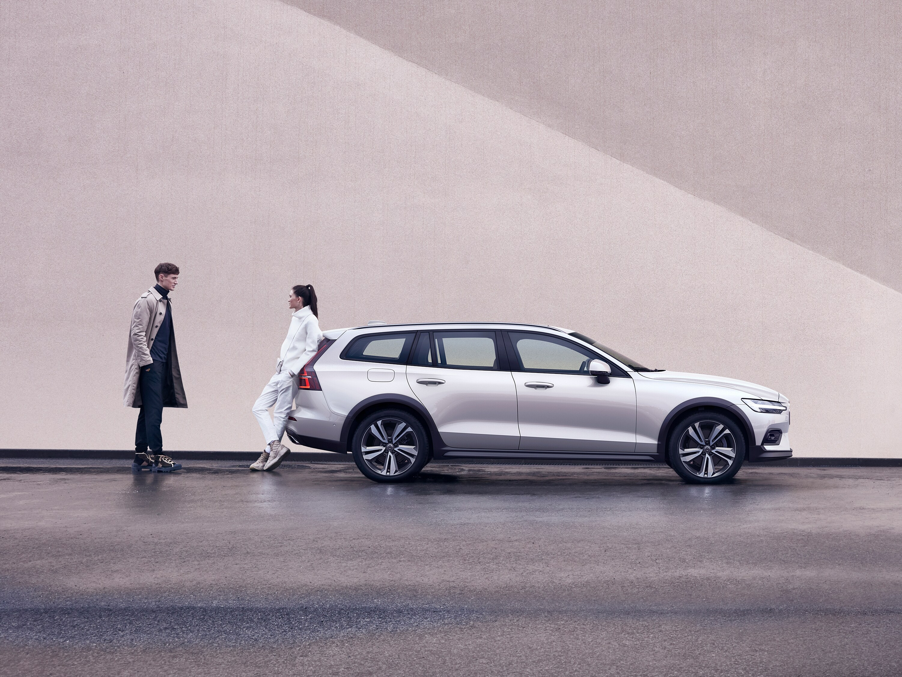Volvo owners stand next to their Volvo V60 Cross Country