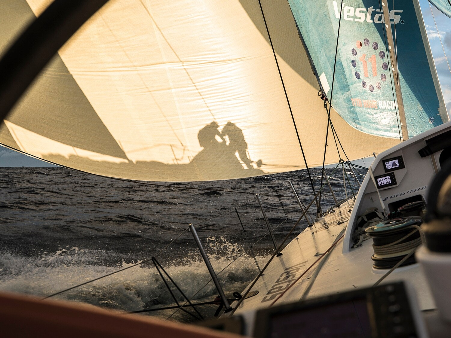 Image of working volvo Ocean Race crew projectected onto a sunlit sail
