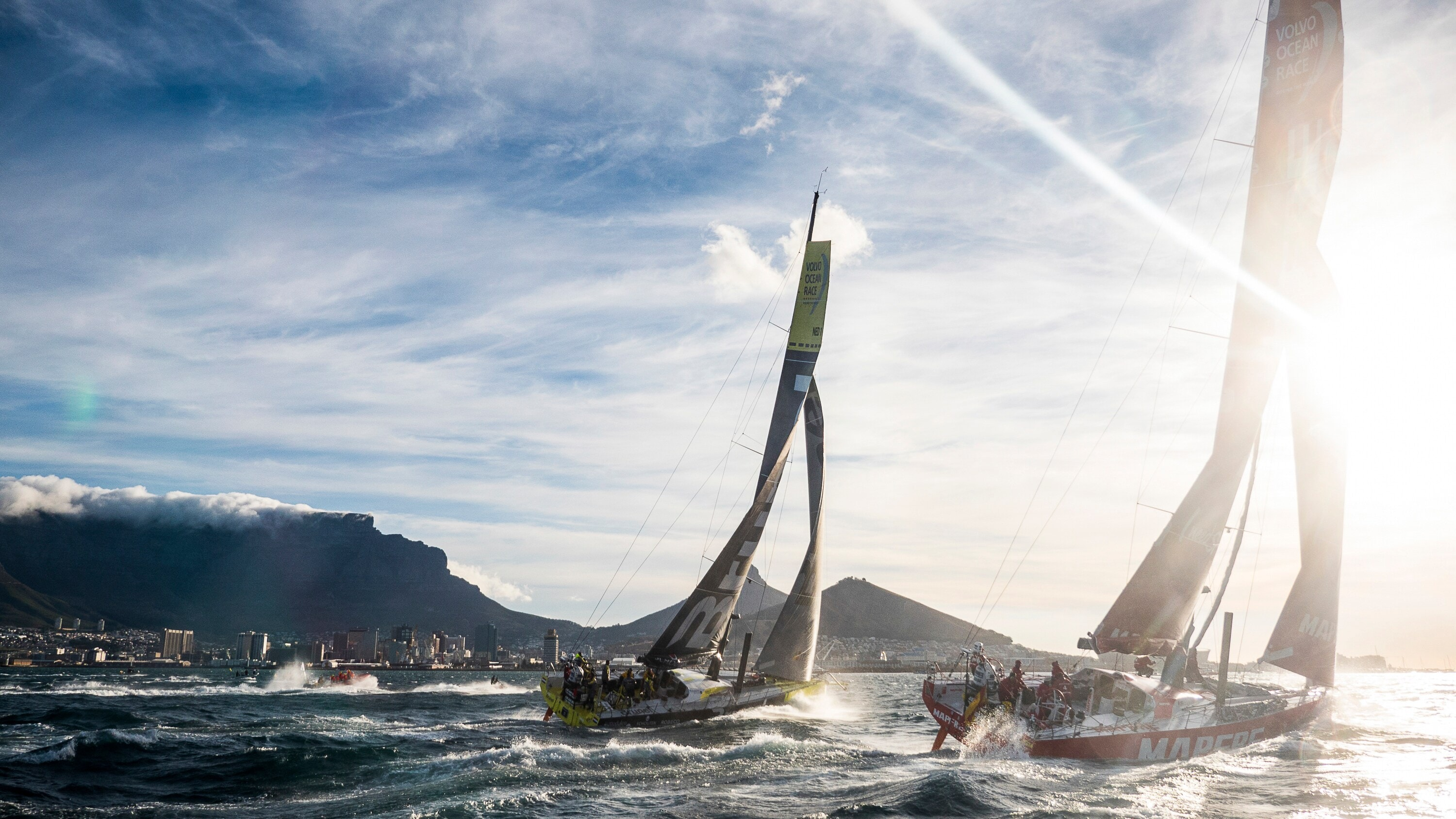Two Volvo Ocean Race yachts sailing outside Cape Town