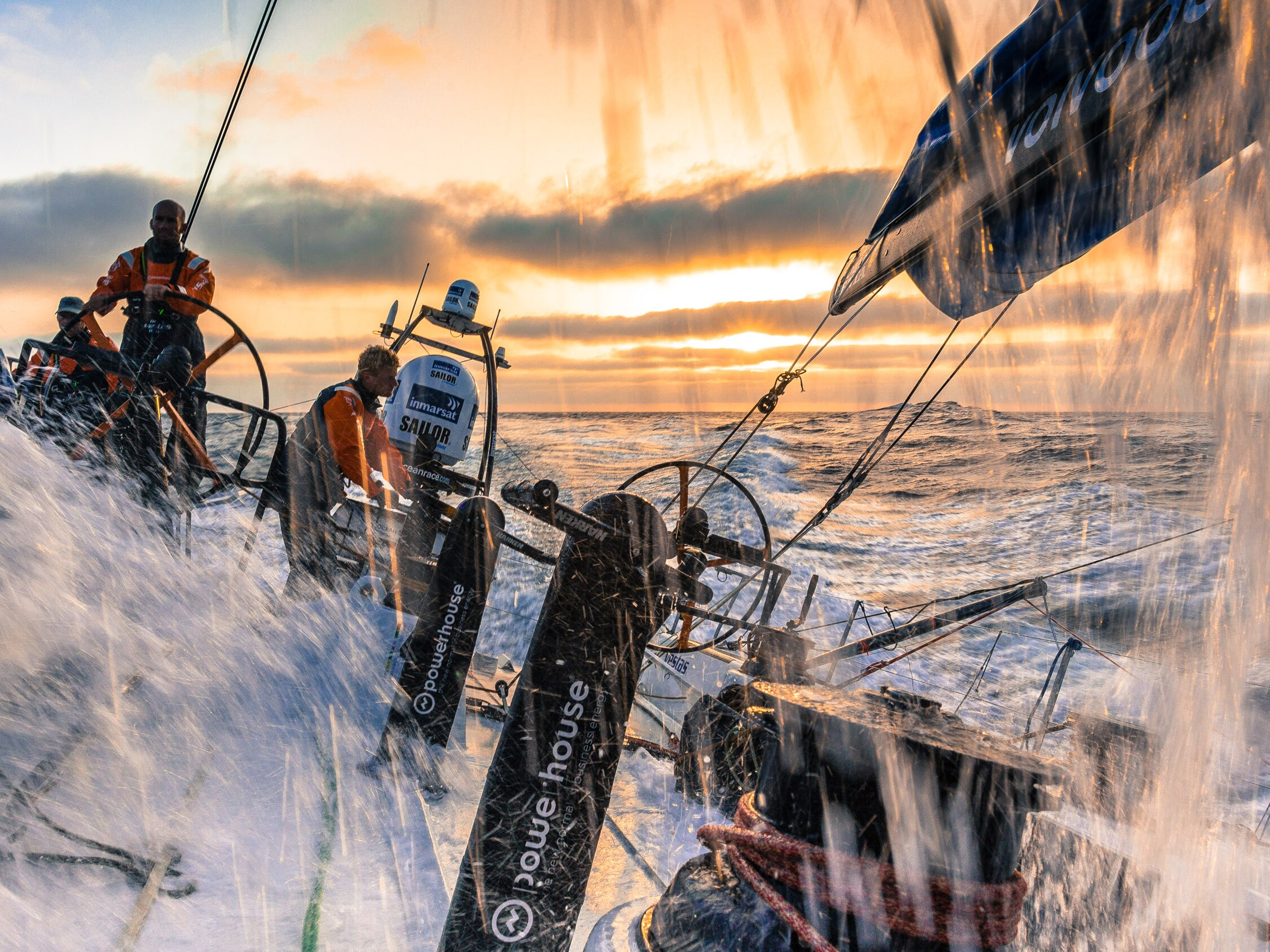 Waves crashing over the deck of a Volvo Ocean Race 65 yacht