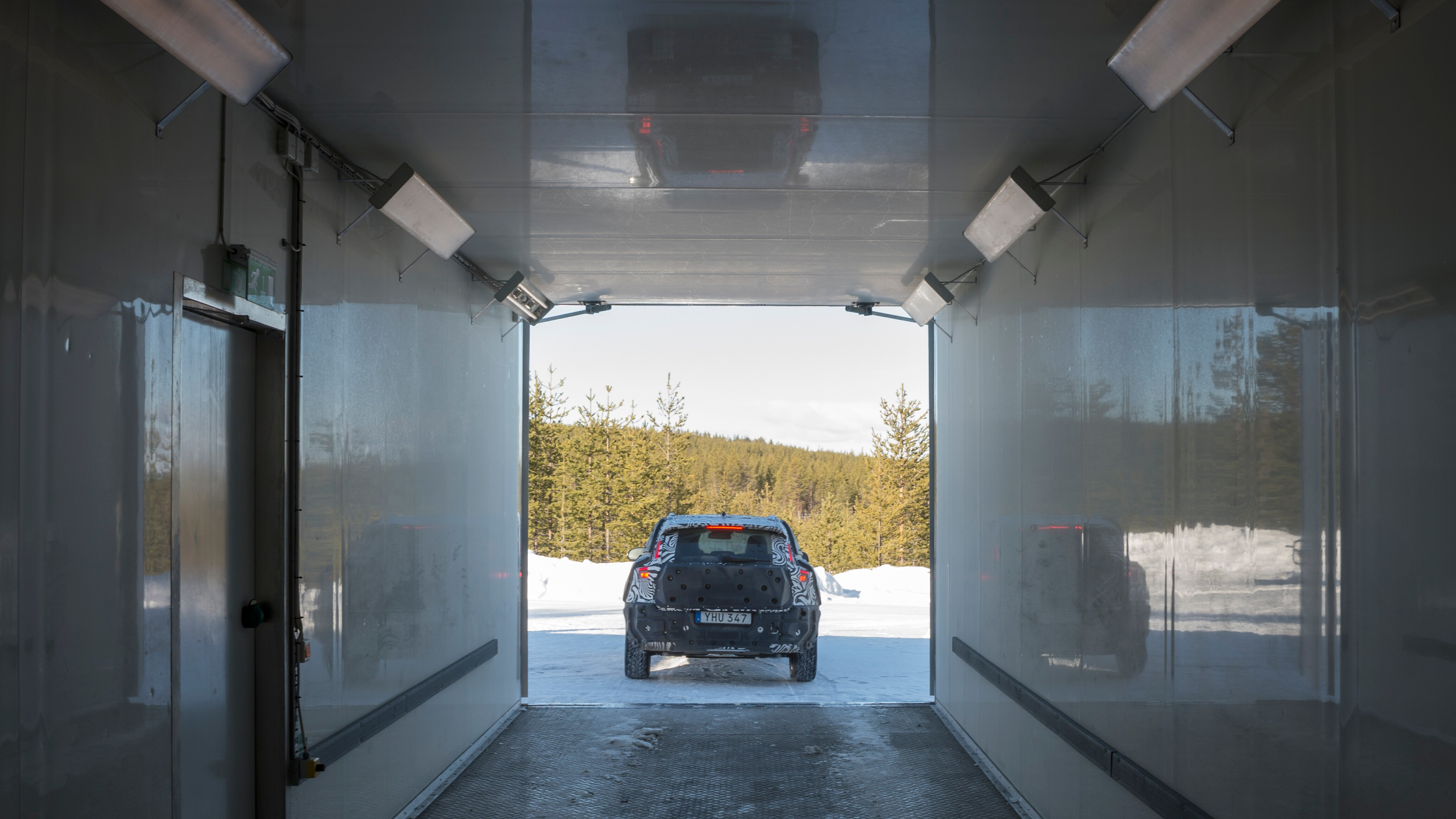 A Volvo XC60 emerges from a -31 degrees Celcius freezer box
