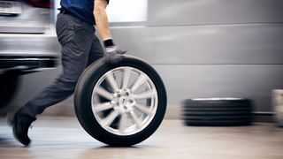 Mechanic spinning a wheel