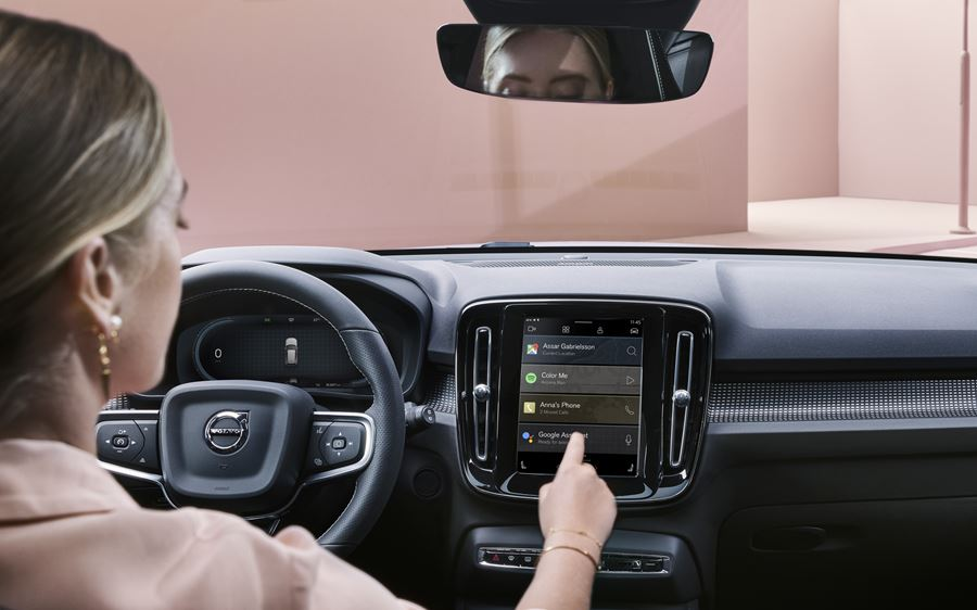 Woman using Google Assistant in XC40 SUV Pure electric